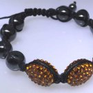 Bracelet with Hematite beads with orange sparkle decor, new not worn