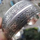Tibetan Silver cuff bracelet with scrollwork vine motif