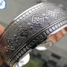 Tibetan Silver cuff bracelet textured with floral motif