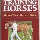 Storey's Guide to Traning Horses  Ground Work - Driving - Riding Soft Cover Book