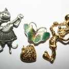 Selection Of Brooches and Heart Pendant