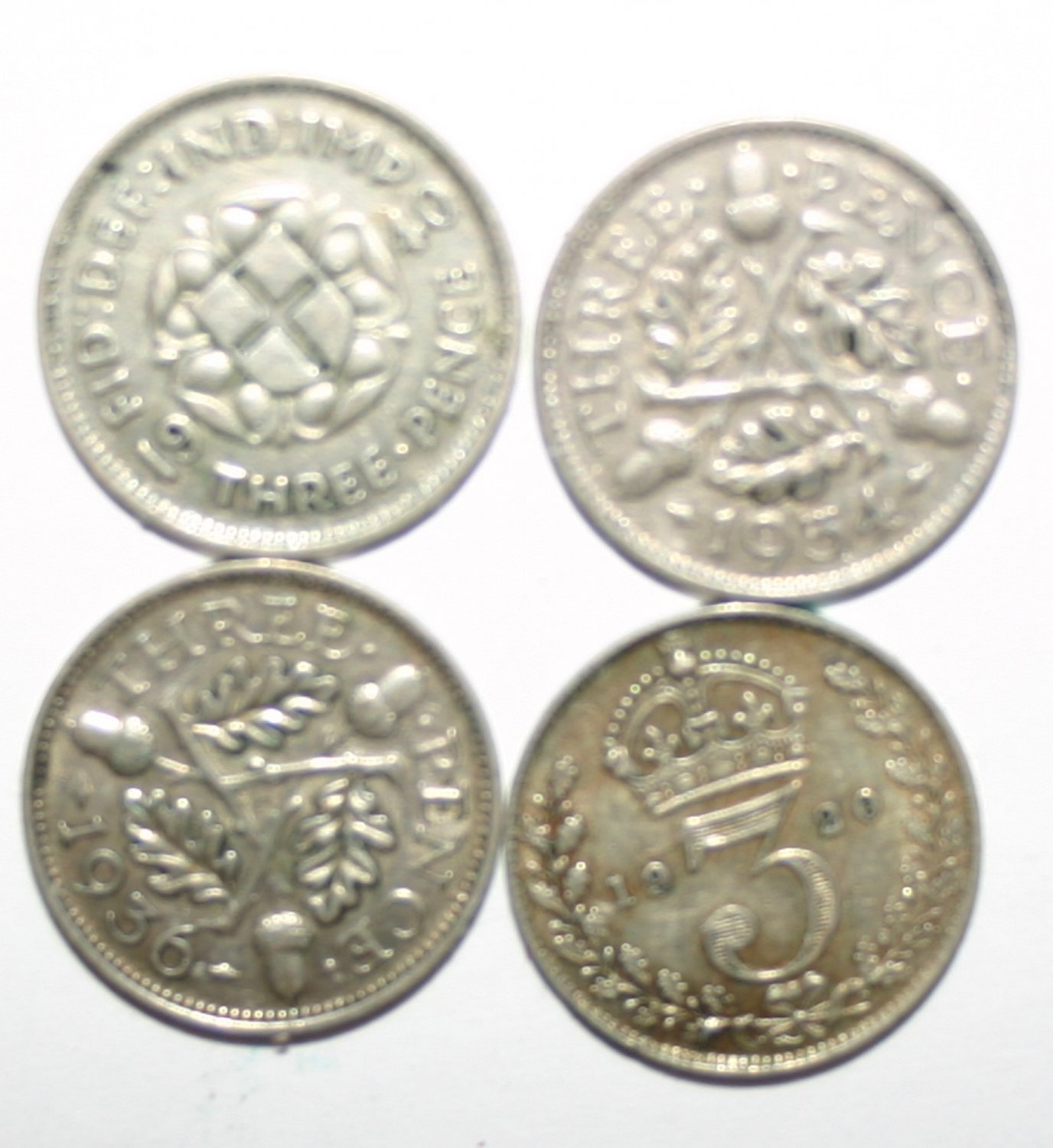 Collection Of Silver Sixpence Coins Dated 1920, 1936, 1940 and 1934