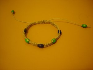 Hemp bracelet; square knot dark blue and green oval beads
