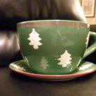 "VERY LARGE COFFEE CUP AND SAUCER CHRISTMAS PLANTER...CUP IS 7 1/2"" PLATE IS 12"""