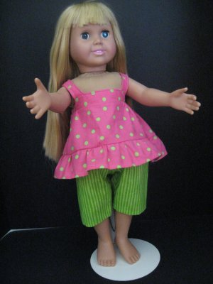 Green dot shirt and striped capris for American girl