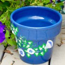 Blue Flower Pot with Blue and White Flowers