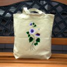 Tote Bag with White and Lavender Flowers and Butterfly Charm.