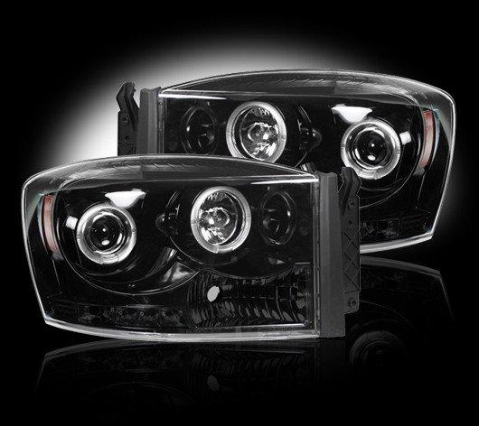 Part # 264199BK - SMOKED Projector Headlights Dodge RAM 06-08 w LED Halos & DRLs
