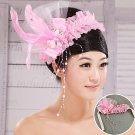 Bridal headdress of pink feathers