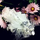 A pair of BRIDAL WEDDING WHITE PEACOCK FEATHER FAUX PEARL RHINESTONE SHOES CLIP