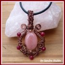Morganite Ornate Pendant with Rubies wire wrapped in Antique Copper, with Black Leather Necklace