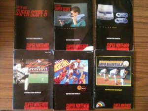 Lot of six (6) SNES instruction booklets: Super Scope, SNES, Sports Games