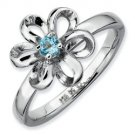 Silver stackable ring with blue topaz flower