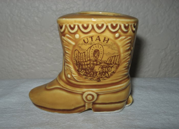 """Gold Colored Ceramic Boot Marked """"Utah"""" on Side."""