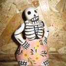 Ceramic Day of the Dead Figure, Woman in Pink Skirt with Yellow Flower Design