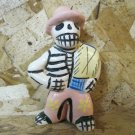 Ceramic Day of the Dead Figure, Man Wearing Hat Holding Blanket