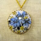 Circular Cameo Pendant, White with Blue and Yellow Flowers Print, Gold Chain