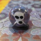 Glass Bead White Pirate Skull and Cross Bones with Purple Background