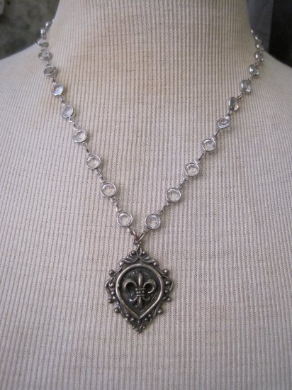 Silver Fleur De Lis Shield Pendant on Silver Wrapped Crystal Chain Necklace