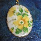 Oval Cameo Necklace, White Background with Yellow Flowers