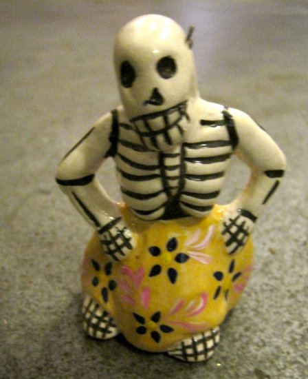 Ceramic Day of the Dead Figure, Woman in Yellow Skirt with Dark Blue Flower Design