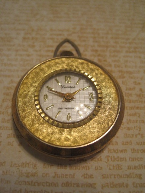 Gold Colored Watch Charm with Flower Pattern on Back