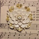 White Celluloid Flower with Yellow Rhinestones