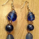 Earrings- Silver  Wire hooks, Blue beads with wire, blue swirls and curved ovals