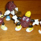 VINTAGE CALIFORNIA RAISINS FIGURINE SET OF 7 PVC TRUMPET SKATES GUITAIR BUGIE