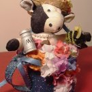 COLLECTIBLE CUTE STAFFED ANIMAL COW FIGURINE WITH FLOWERS IN A WATER CAN
