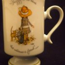 VINTAGE HOLLY HOBBIE PORCELAIN MUG HAPPY IS THE HOME THAT WELCOMES A FRIEND