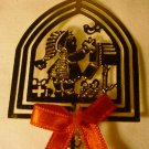 BRASS TIN CHRISTMASS ORNAMENT ON A STICK KID WITH PRESENTS SHADOW