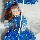 VINTAGE BLUE ROSETTE BEADS DOLL WITH UMBRELLA