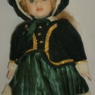 CHARMING DOLL IN A GREEN WINTER OUTFIT