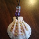 22 inch handmade seashell necklace with gold beads and purple, pink and clear pony beads