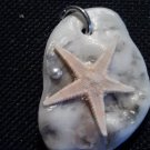 seashell shard pendant with starfish and white pearl bead