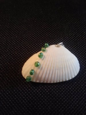 seashell pendant with green beads