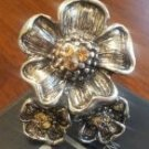 Silver flower ring with light orange accent jewels
