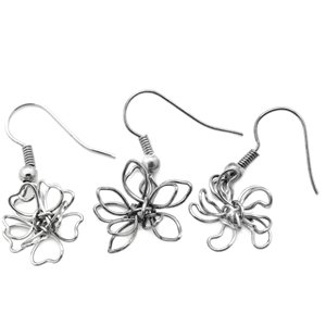 One pair child's size dangle silver flower earrings