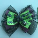 Black and Green Bat Bow
