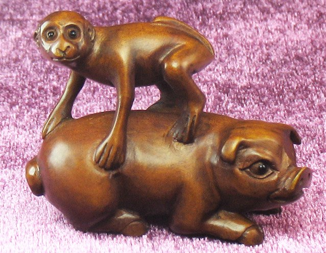 WS0108 Hand-Carved Boxwood Netsuke Monkey On Pig