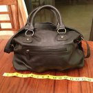 Brash tote style leather hand bag with shoulder strap