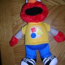 Sesame Street Rockin' Shapes & Colors Talking/Singing Elmo Plush Doll, Price Includes S&H