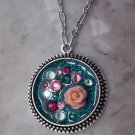Teal glittery pendant necklace round silvertone rose Swarovski crystal sparkly resin