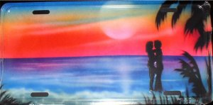AIR BRUSHED MAN AND WOMAN ON BEACH LICENSE PLATES