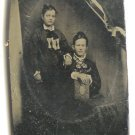 Tin of Women with Photograph Album