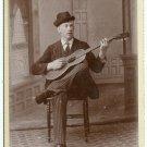 Man Playing Guitar Cabinet Card