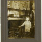 Girl with Piano and Sheet Music