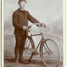Man Standing With His Bicycle