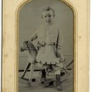 Tintype of a Young Child and Rocking Horse